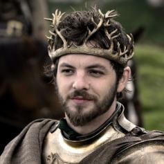 Hubiera sido peor rey que Stannis, pero era mejor persona que cualquiera de sus dos hermanos. Además que te asesine una sombra que ha dado a luz Melissandre es muy siniestro.